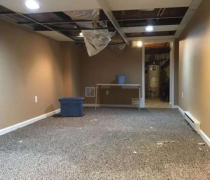 flooded basement with water damage
