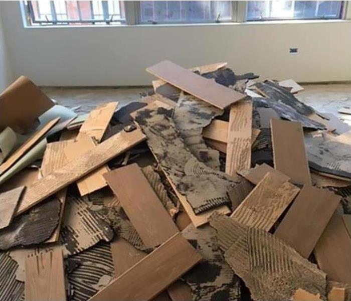 controlled demolition of flooring after commercial water damage